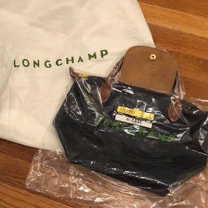 Brand new Longchamp size small navy purse